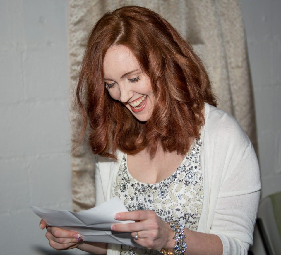 bride smiling as she reads her vows in Erie, PA