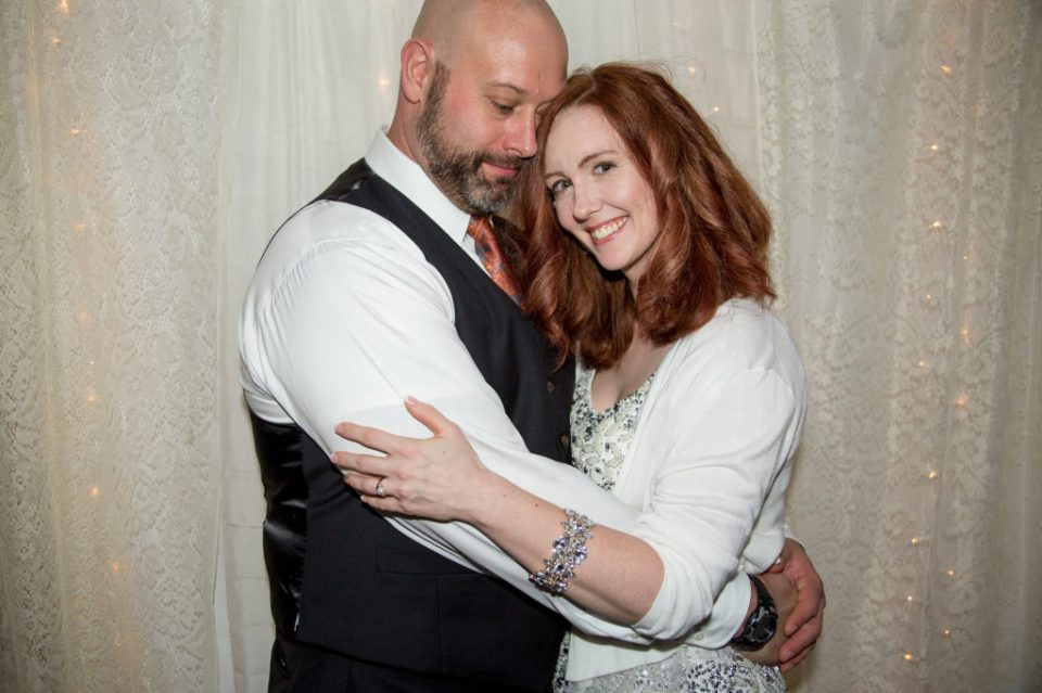 portrait of bride and groom at their cozy DIY wedding in Erie, PA
