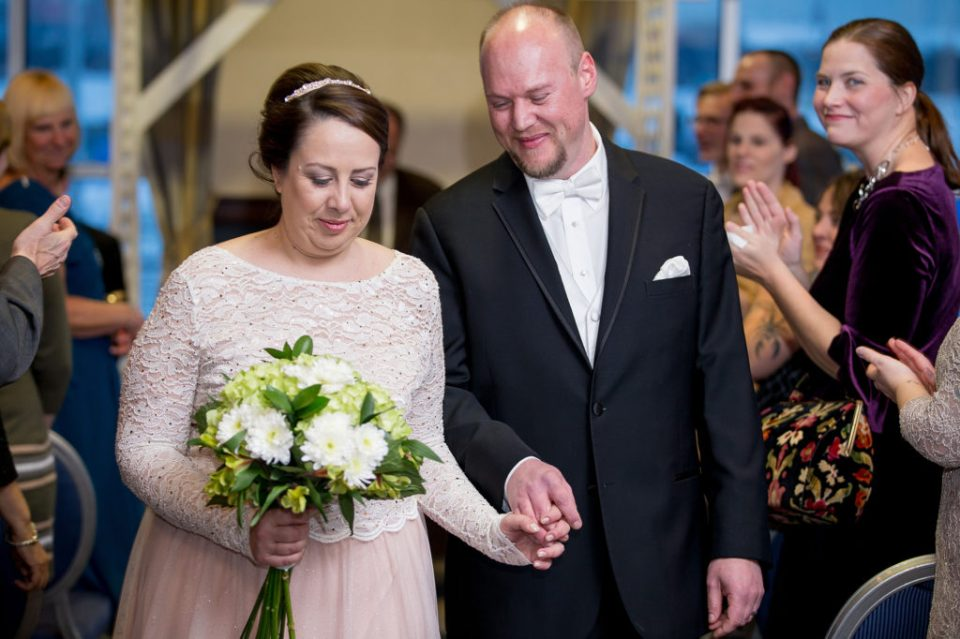 bride and groom walking together at their Sheraton Bayfront hotel wedding in Erie, PA