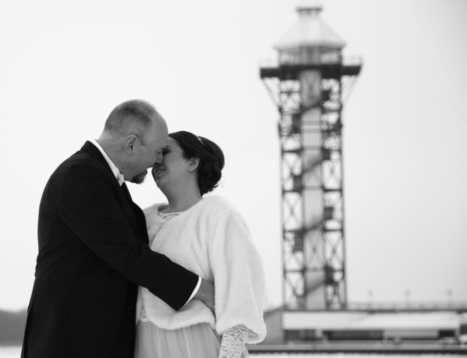 bride and groom about to kiss in front of Bicentennial Tower in Erie, PA
