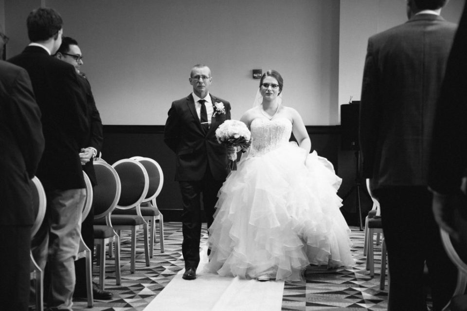 bride walking down the aisle with her father during wedding at Sheraton Bayfront Hotel Erie, PA