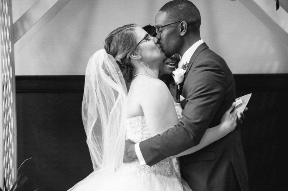 couple's first kiss during wedding at Sheraton Bayfront Hotel in Erie, PA