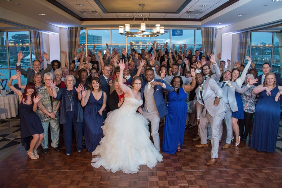 bride, groom and guest smiling and waving during wedding at Sheraton Bayfront Hotel Erie, PA
