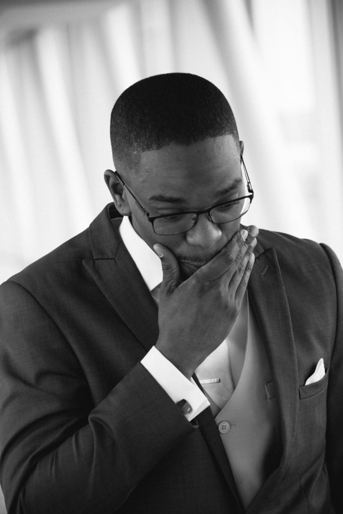 groom reacts to seeing his bride during first look photos at Sheraton Bayfront Hotel