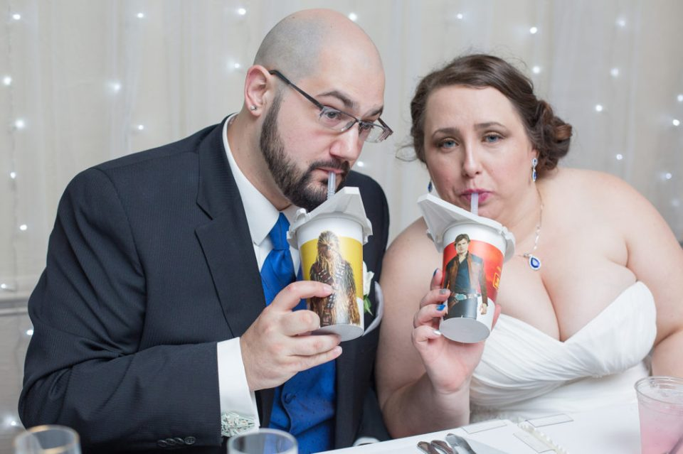 bride and groom drink from Star Wars cups at their Star Wars themed wedding in Pittsburgh PA