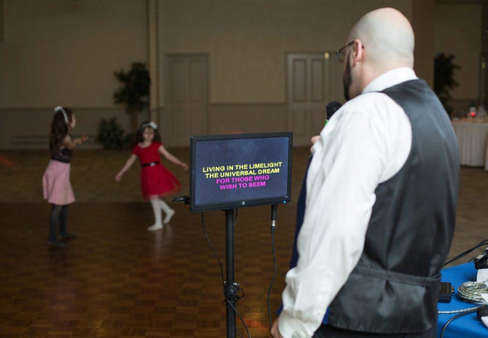 groom sings karaoke at Star Was themed wedding in PIttsbugh PA