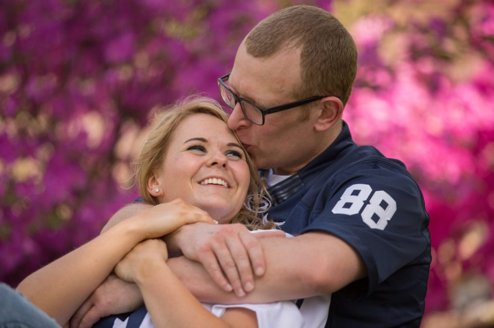 Man kisses woman on forehead during Penn State Erie engagement session