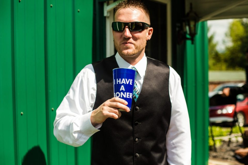 """best man holds """"ceremonial"""" cup at Erie PA backyard wedding"""