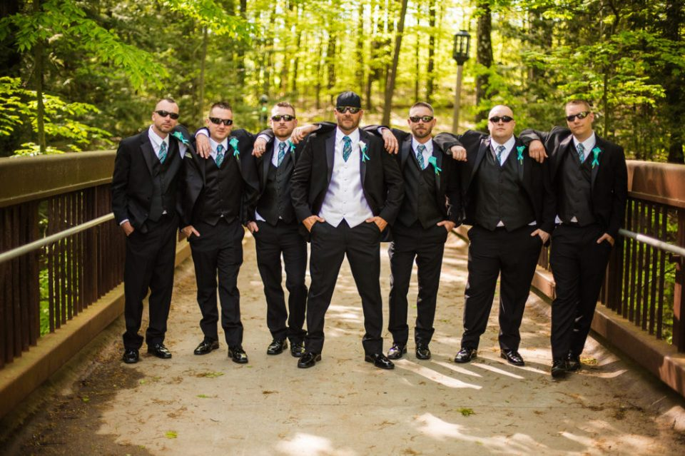 groom with his groomsmen during portraits at Erie PA wedding