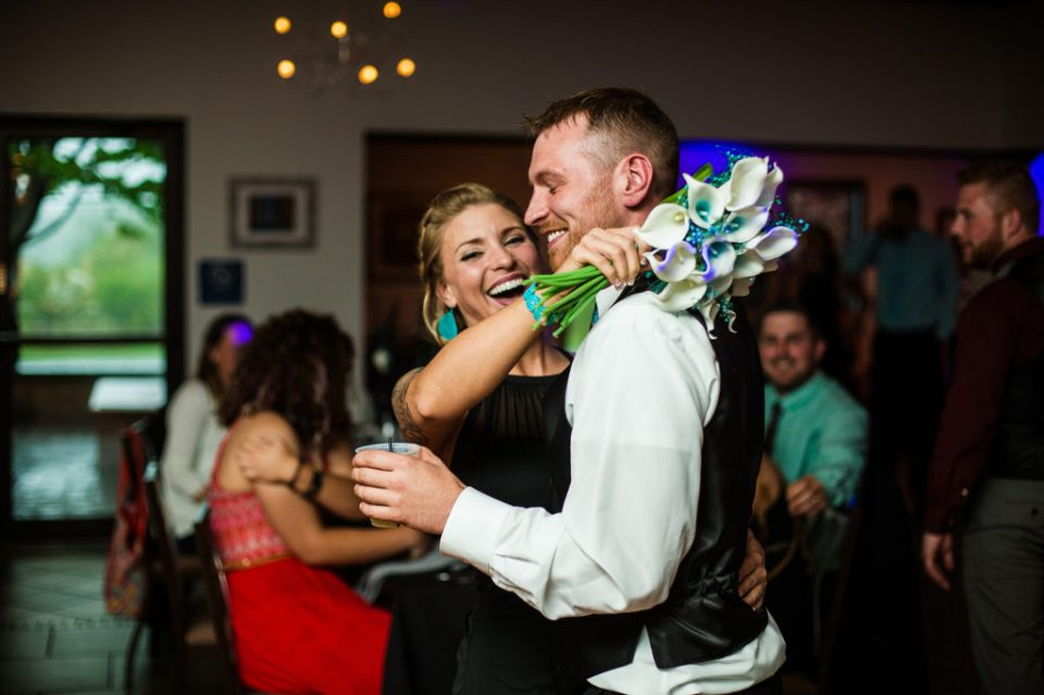 two members of bridal party handed the bouquet and garter at Erie PA wedding