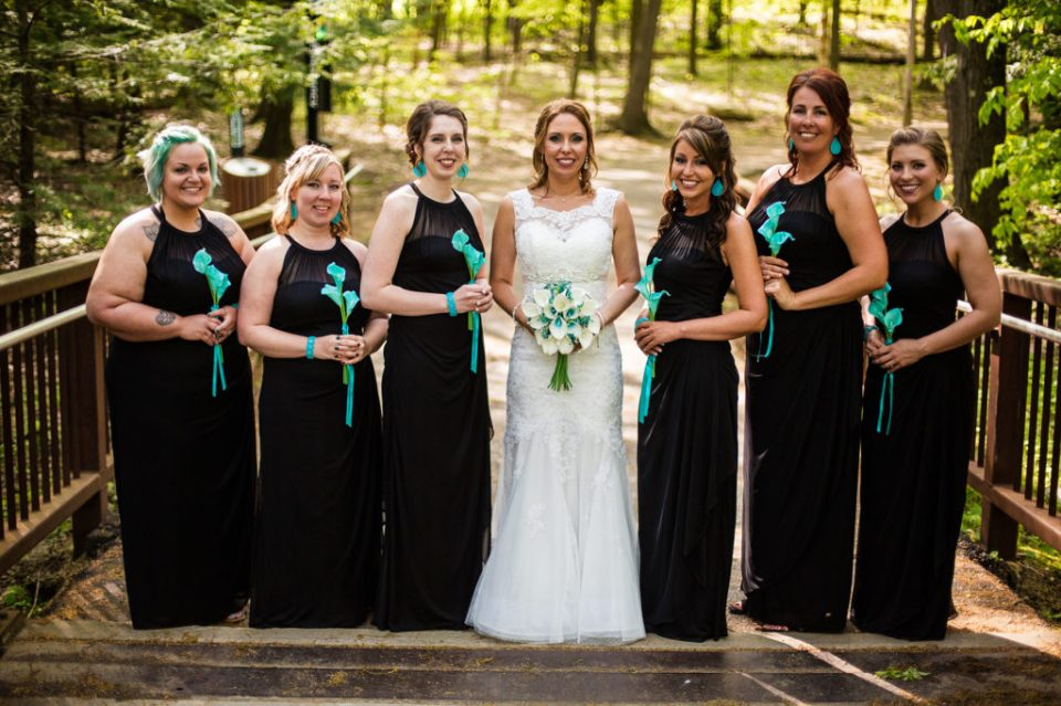 bride with her bridesmaids during Erie PA wedding