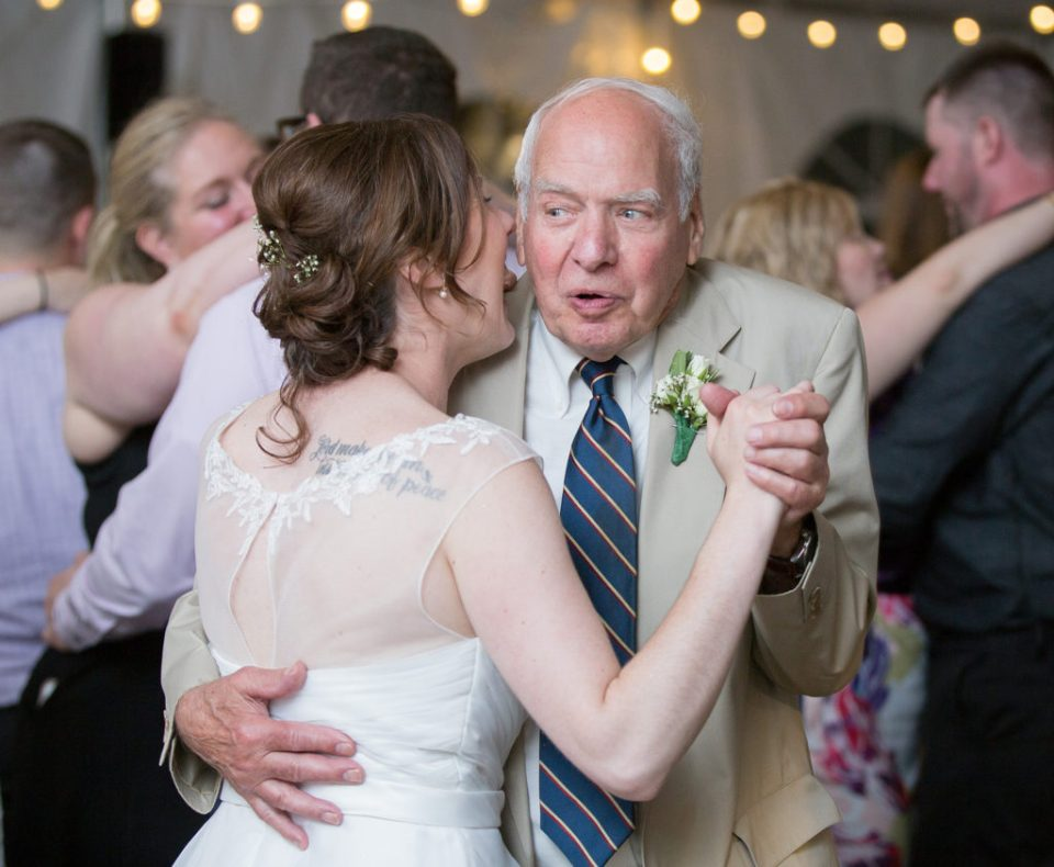 bride shares a laugh with her new father-in-law at Pittsburgh National Aviary wedding reception