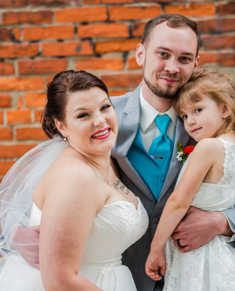 bride, groom and her daughter during Brewerie wedding in Erie PA