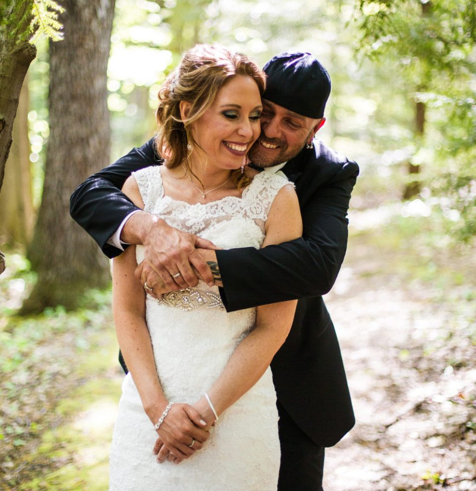 Erie PA couple enbrace during bridal portraits on Penn State Behrend campus