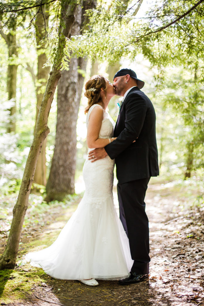 Erie PA couple kiss during bridal photography at Penn State Behrend campus
