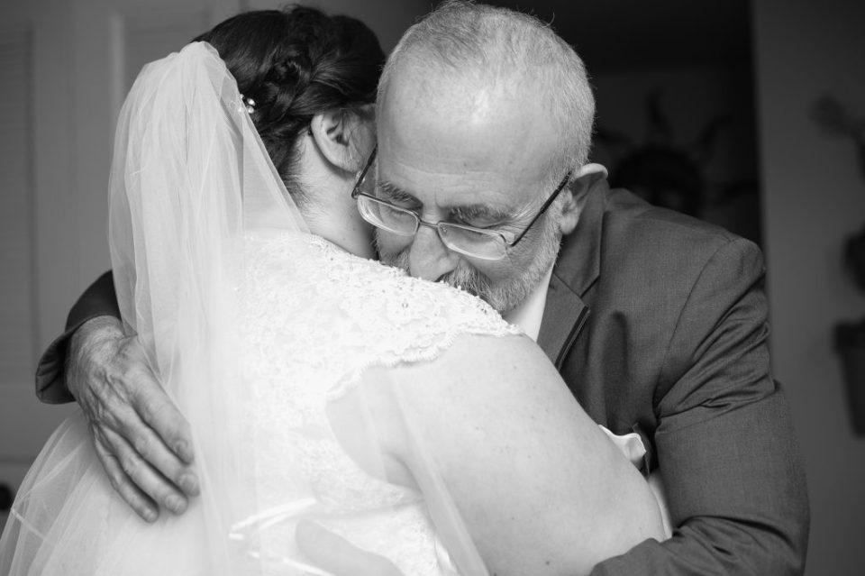 father and bride hug on her wedding day