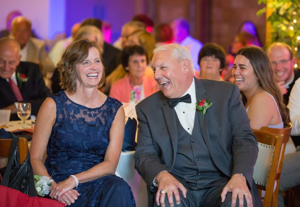 Mother and Father of the bride laughing during Saint Patrick's wedding reception