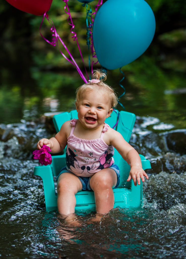 girl poses and smiles for first year photos at Frontier Park in Erie PA