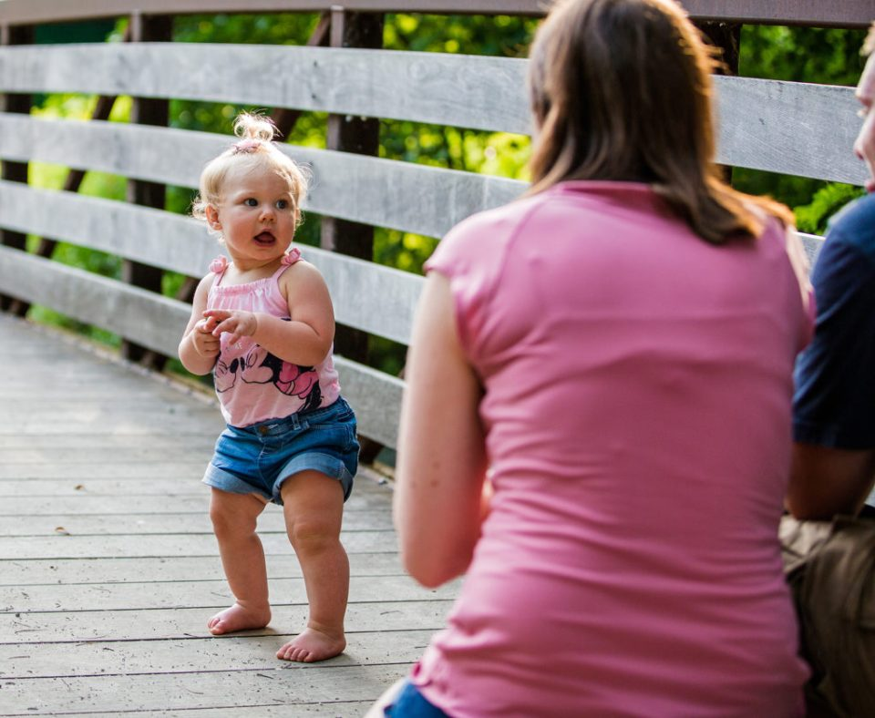 girl looks at her mother during first year photos at Frontier Park in Erie PA
