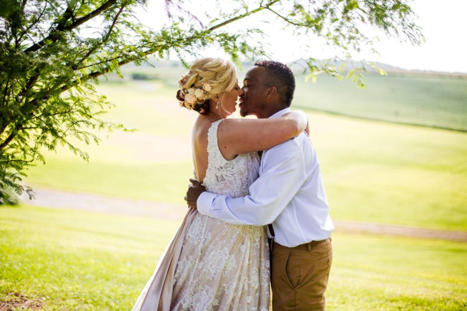 couple about to share a kiss at Betsy's Barn wedding