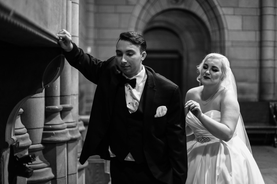 a black and white image of Jon's reaction to Alexsys during their first look in the cathedral of learning at Pitt