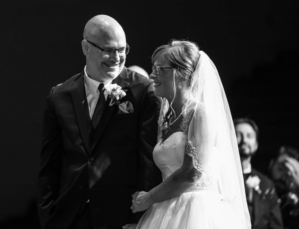 bride and groom smile at each other during Erie PA wedding ceremony