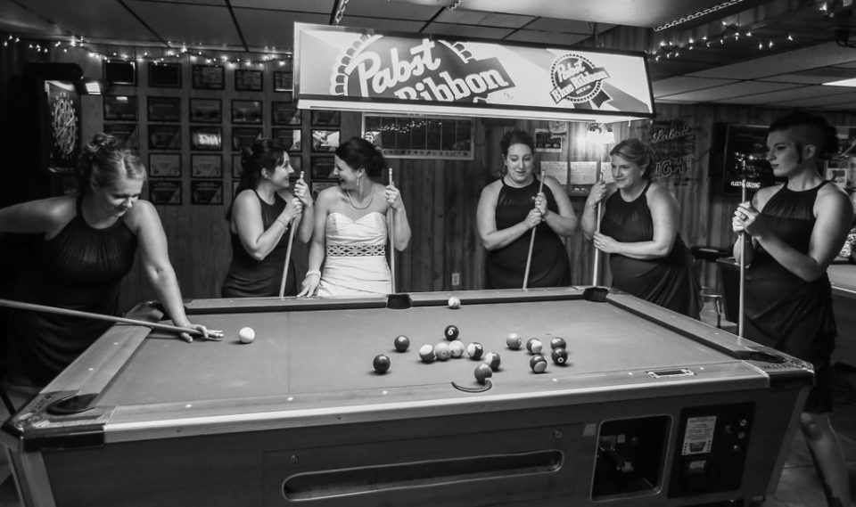 Bride and bridesmaids reenacting the famous Rat Pack playing pool photo