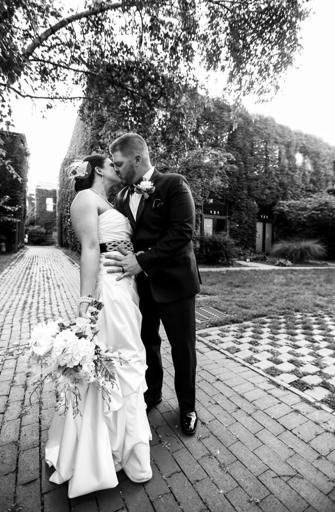 Iconic Black and White Bridal Portrait of the bride and groom kissing at Justin and Amandas Warner Theater Wedding