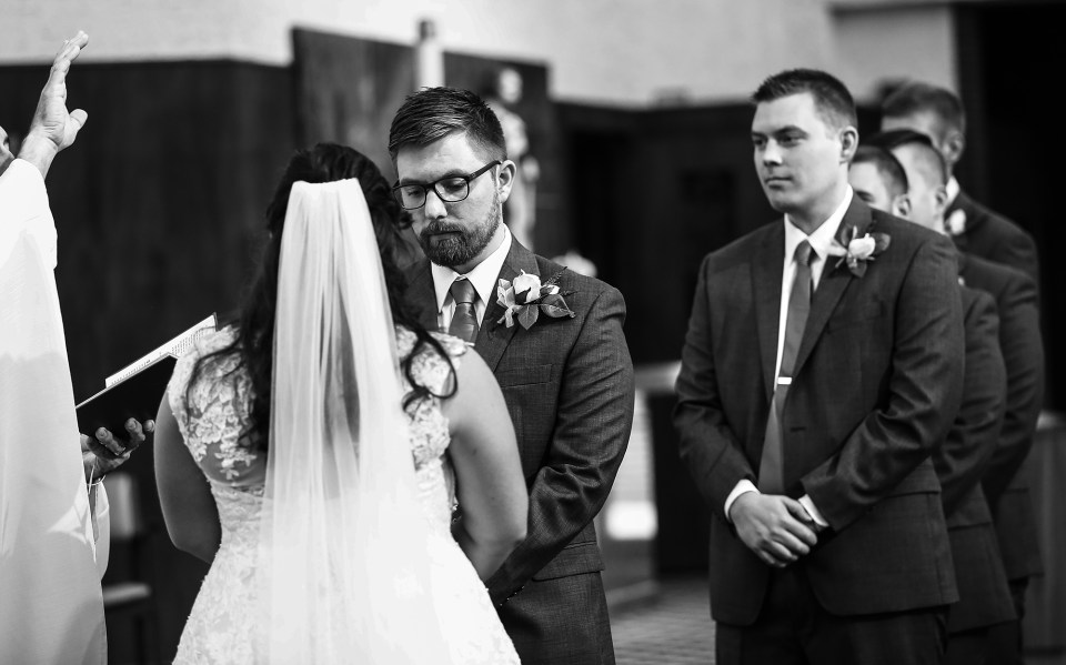 Erie, PA bride and groom exchange vows at Blessed Sacrament Church