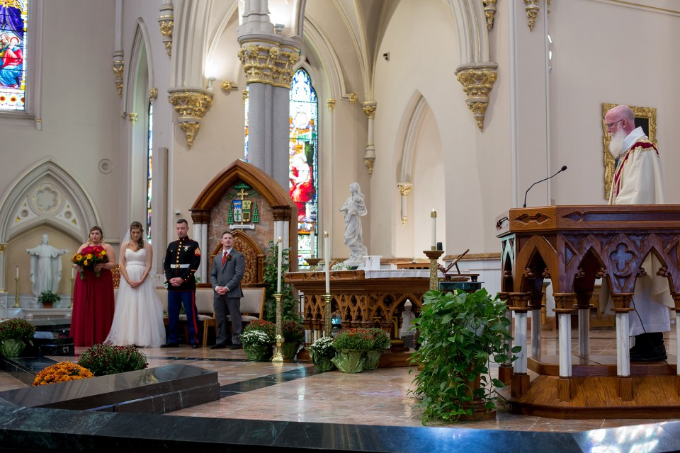 priest addresses bride and groom at St Peter Cathedral in Erie PA