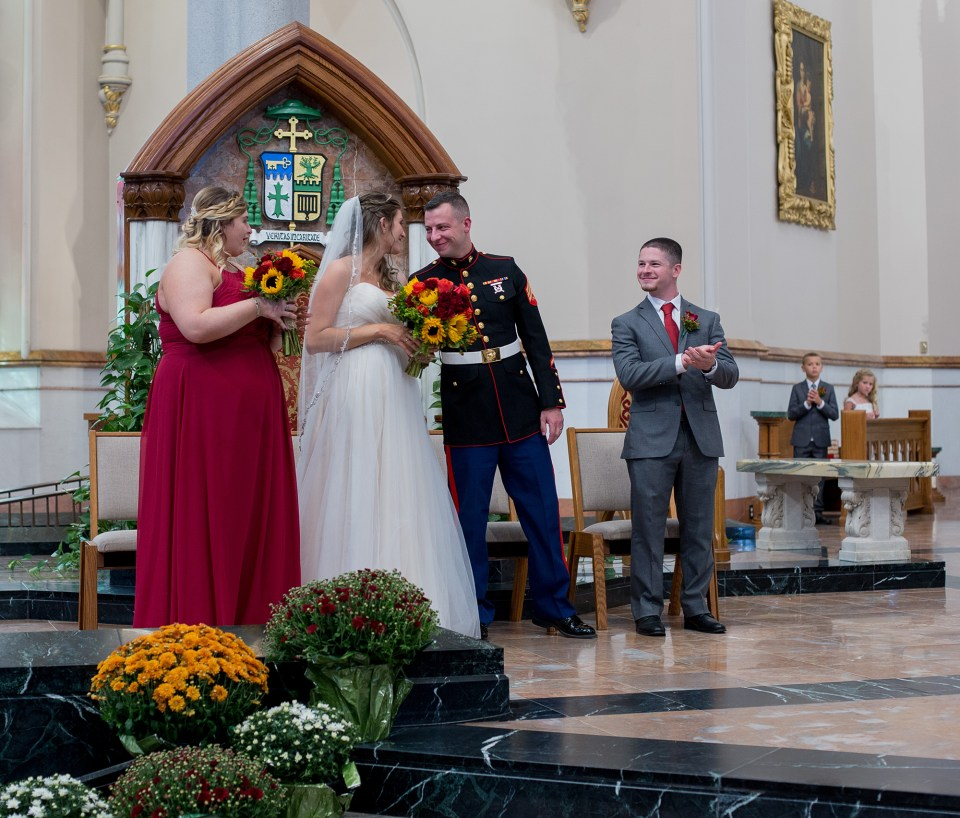 bride and groom exchange smiles at St Peter Cathedral in Erie PA