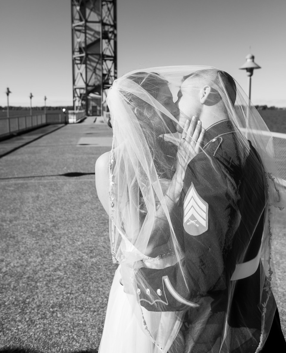 Bride and Groom kiss under her veil in front of Bicentennial Tower in Erie PA