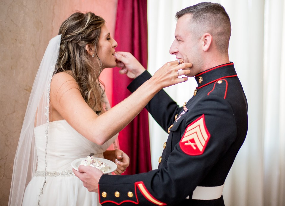 Erie PA bride and groom feed each other cake at Concourse at Union Station wedding reception