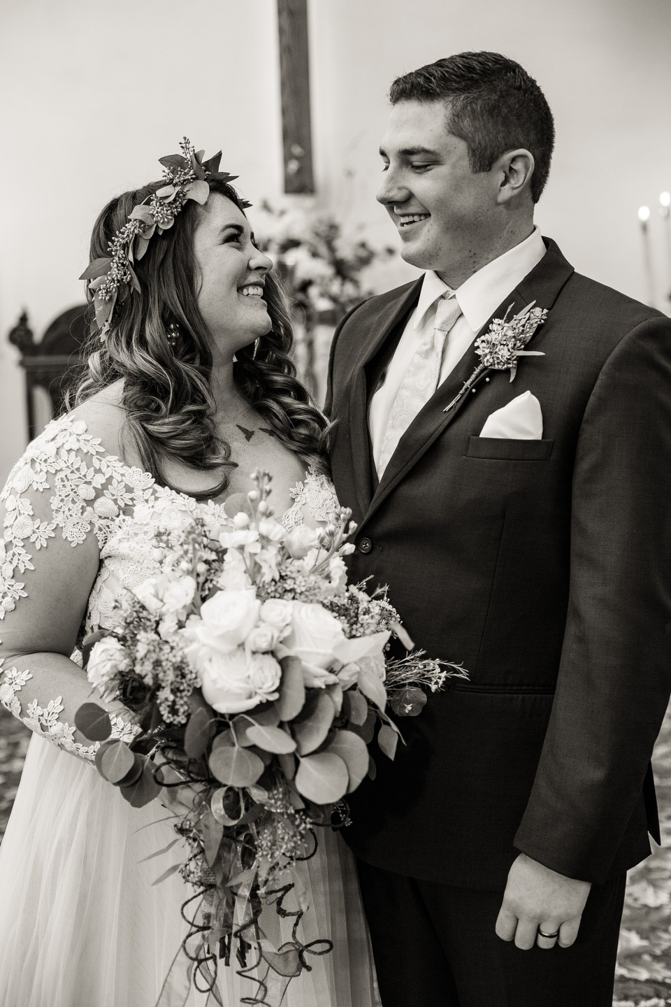 Bride and groom smile at each other after their wedding at First Presbyterian Church
