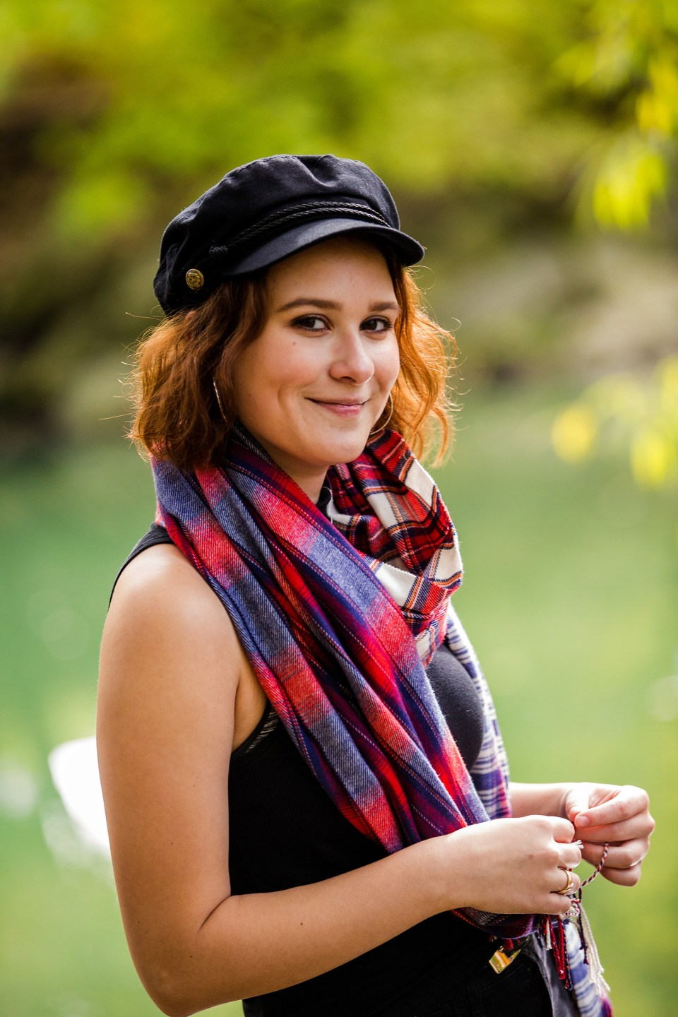 Girl wearing hat and plaid scarf for Erie PA senior portraits