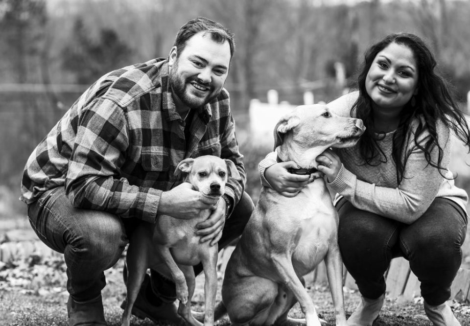 Couple poses with their dogs during winter engagement photos
