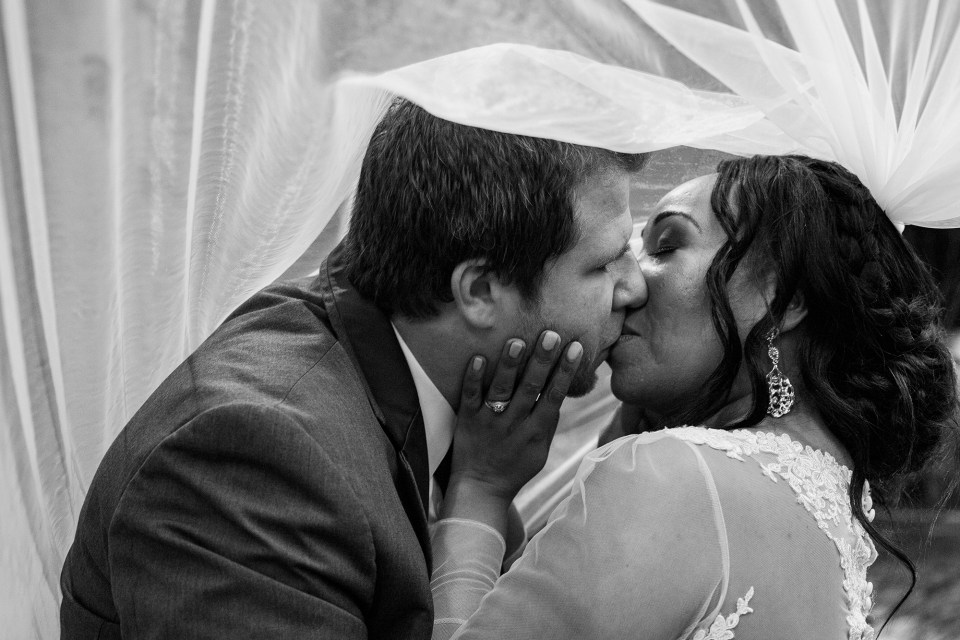 Pittsburgh couple kiss under bride's veil at Laughlin Memorial Library