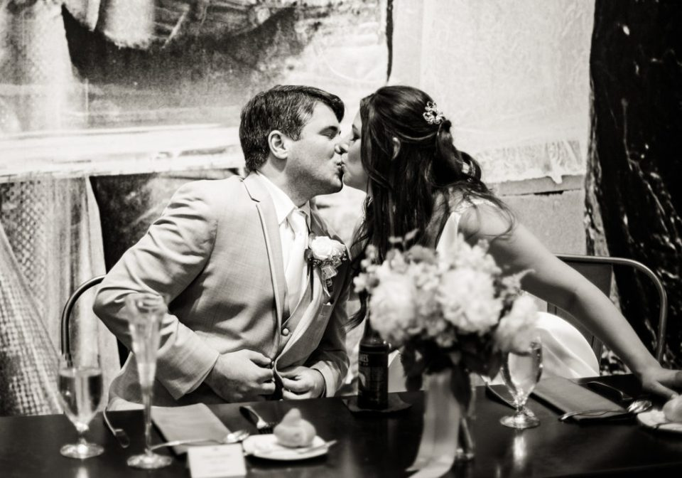 Bride and groom kiss suring their Pittsburgh wedding reception at the Andy Warhol Museum