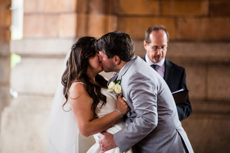 First kiss at a Pittsburgh wedding in the Rotunda at the Pennsylvanian Apartments