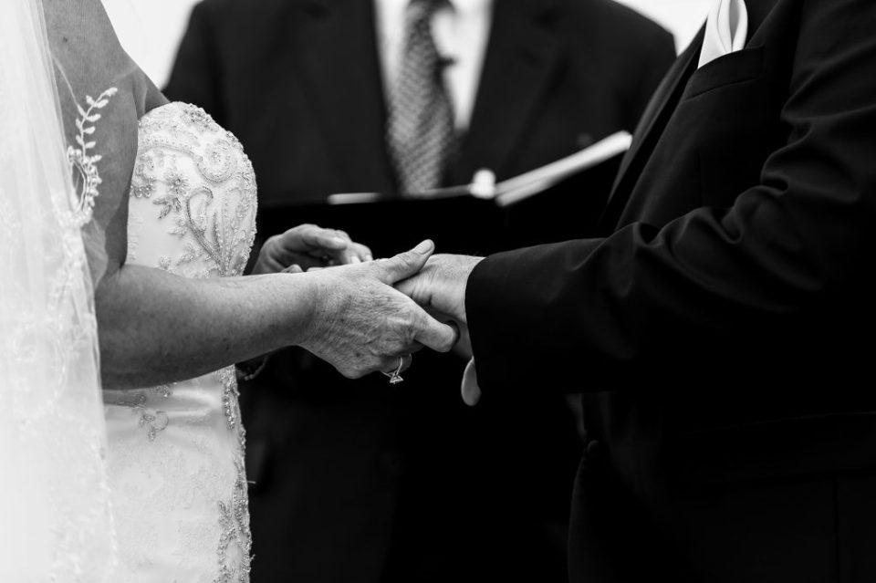 Couple exchanges rings during spring vow renewal at Sheraton Erie Bayfront Hotel