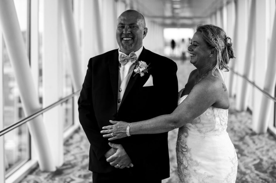 Bride and groom's first look on the skybridge at the Sheraton Erie Bayfront Hotel