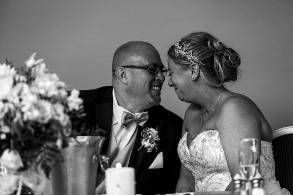 Bride and groom laugh together during reception at Sheraton Bayfront Hotel