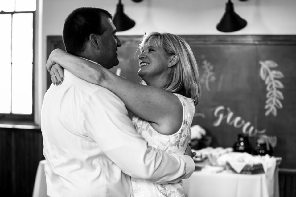Couple shares first dance during wedding at the Schoolhouse