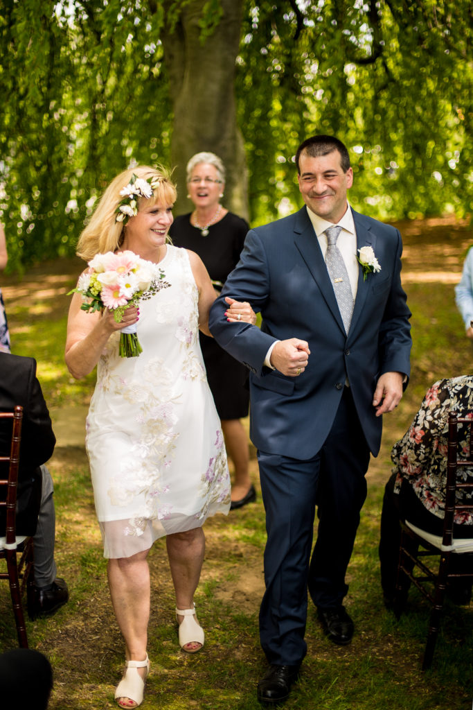 Bride and groom walk down the aisle at the end of their wedding at the Schoolhouse