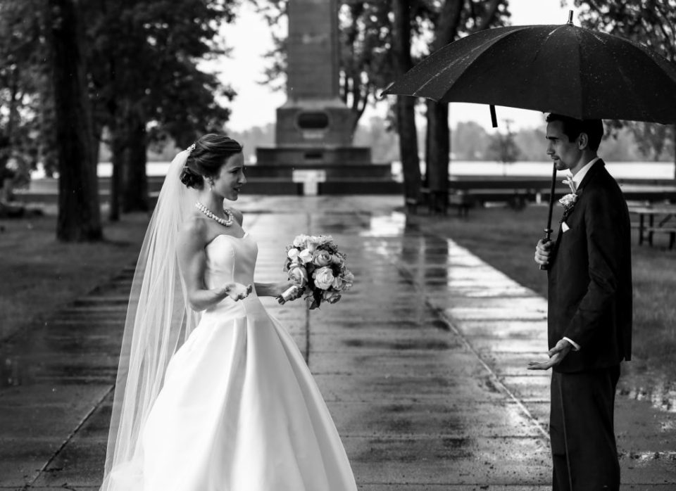 Bride questions why groom is under umbrella during rain storm at Perry Monument on Presque Isle State Park