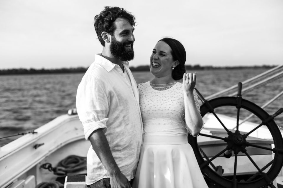 Bride and groom laughing at their tall ship wedding on the Lettie G Howard