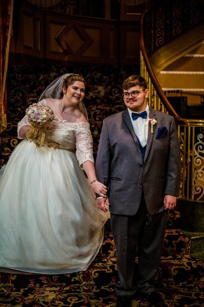 Bride surprises groom during first look at a summer Warner Theatre wedding