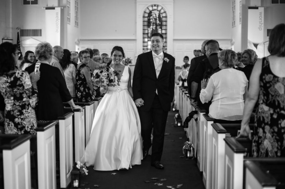 Recessional photo of bride and groom at Emmanuel Presbyterian Church wedding
