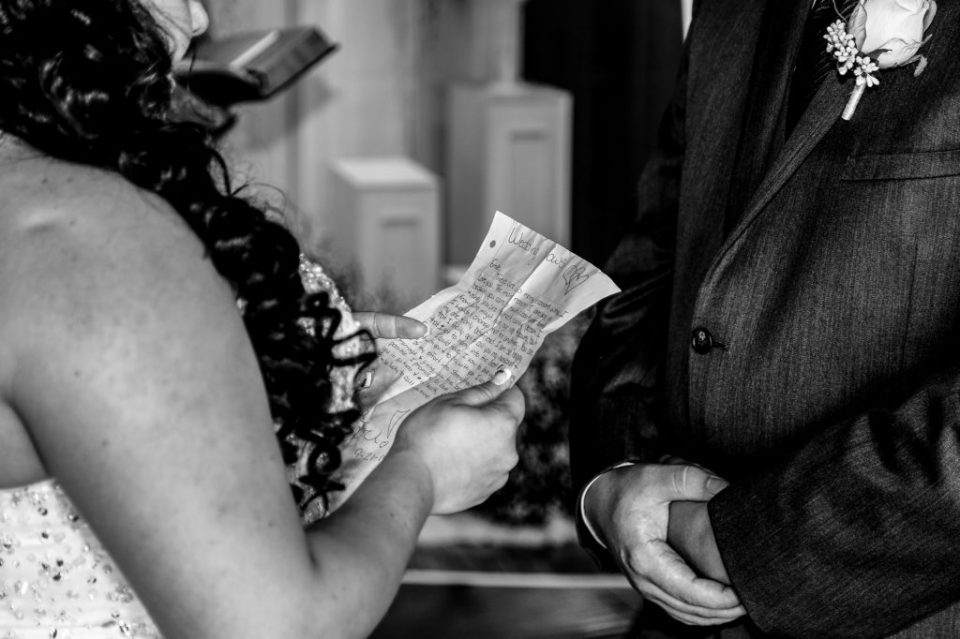 Bride reads her vows at a rustic Connellsville wedding