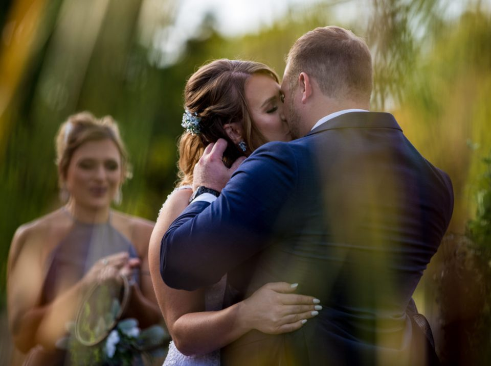 Couple shares first kiss at the end of their Rustic Acres wedding ceremony